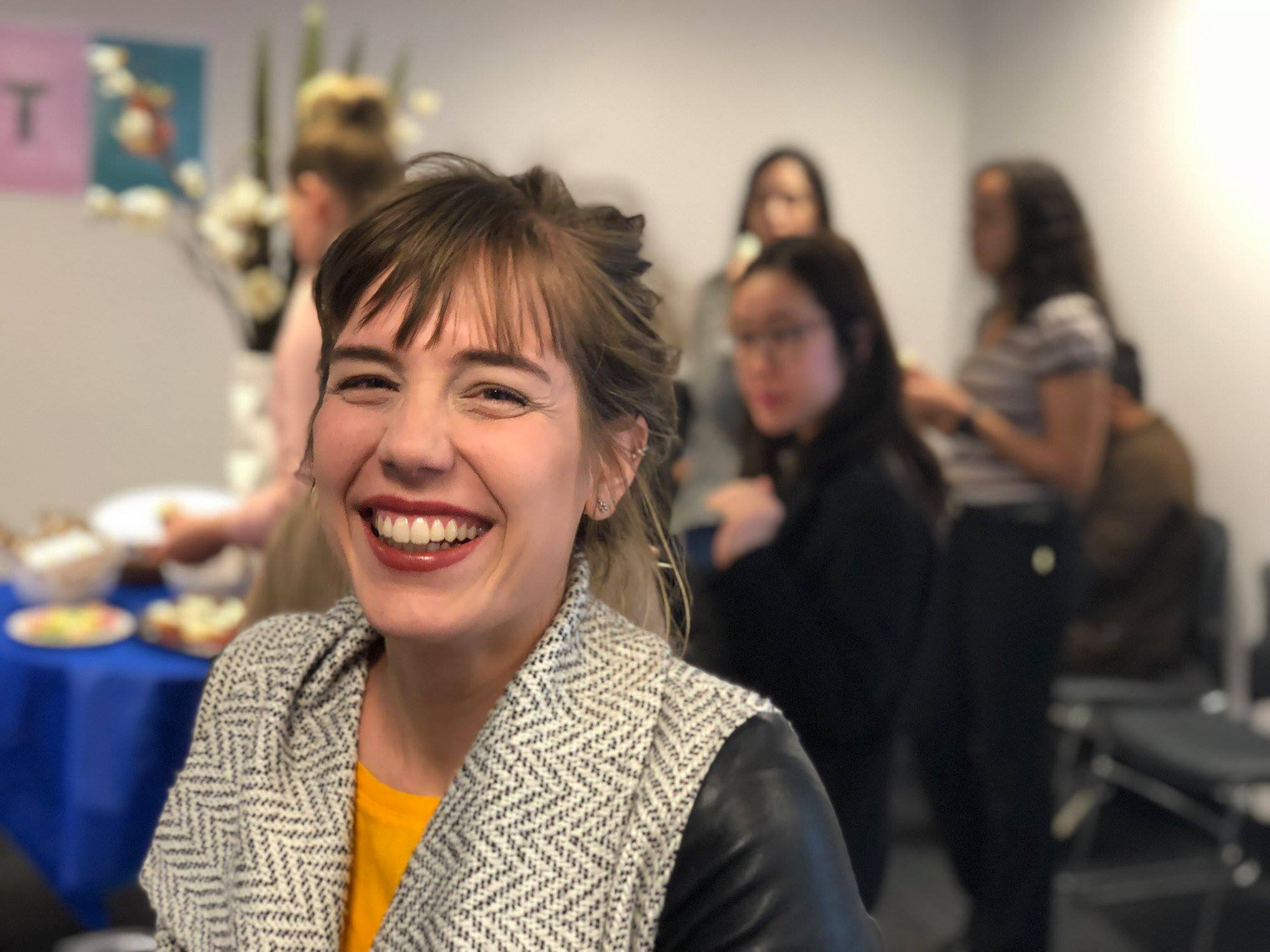 Girl smiling at networking event