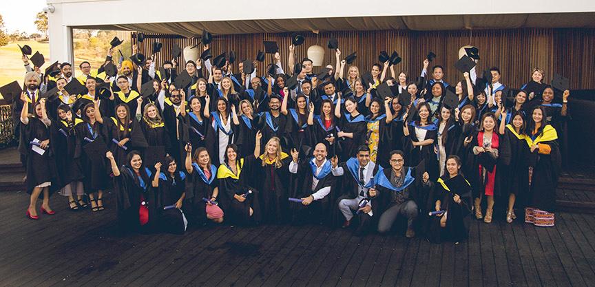 Graduation group shot on wooden deck