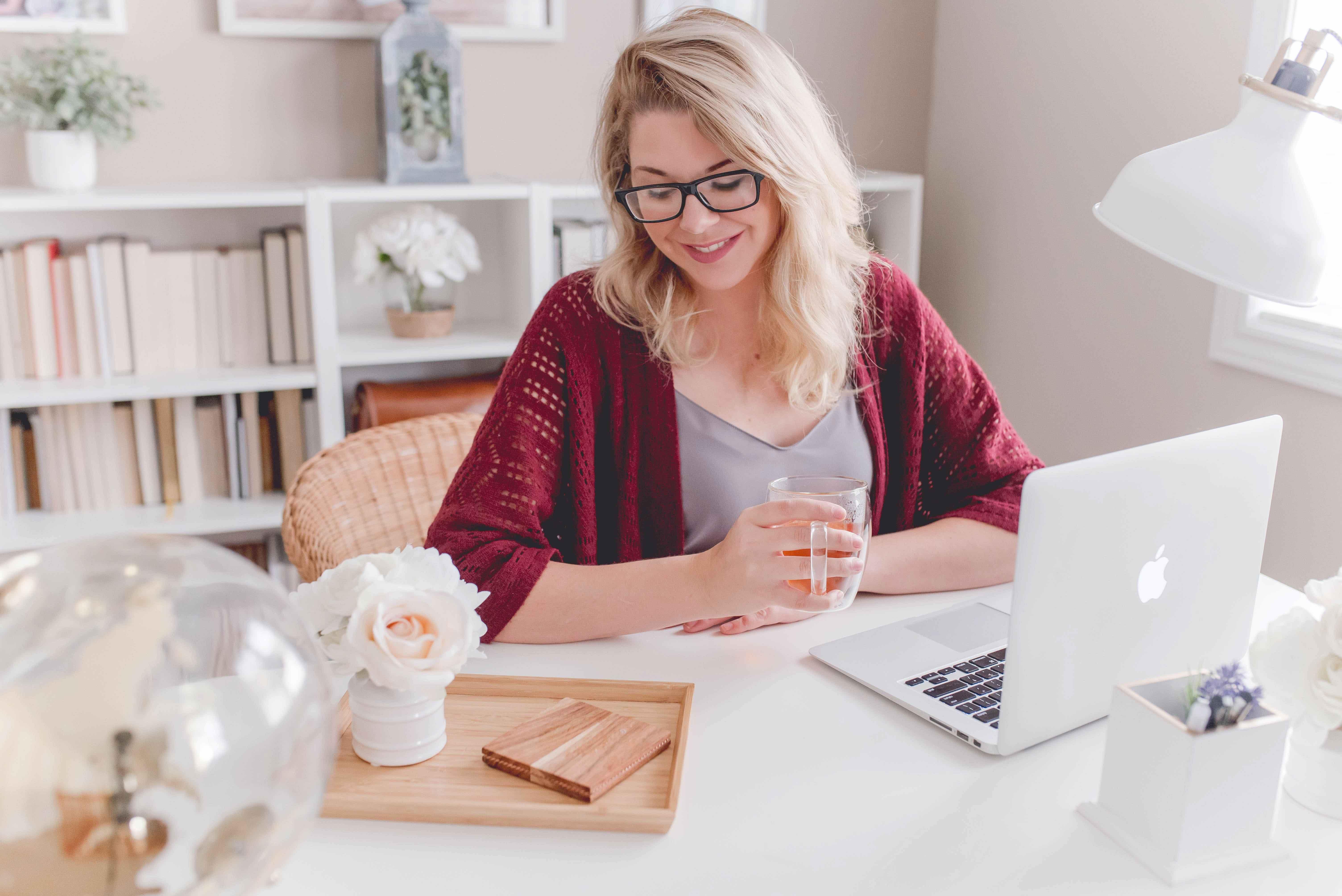 Women at desk working online